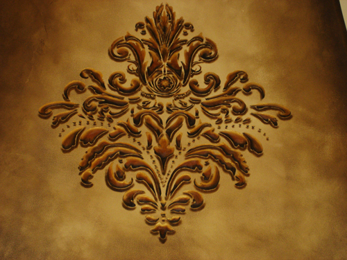 Stencilling scroll designs faux wrought iron